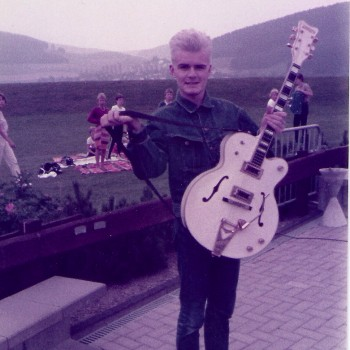 Billy shows off his prized Gretsch White Falcon in 1984
