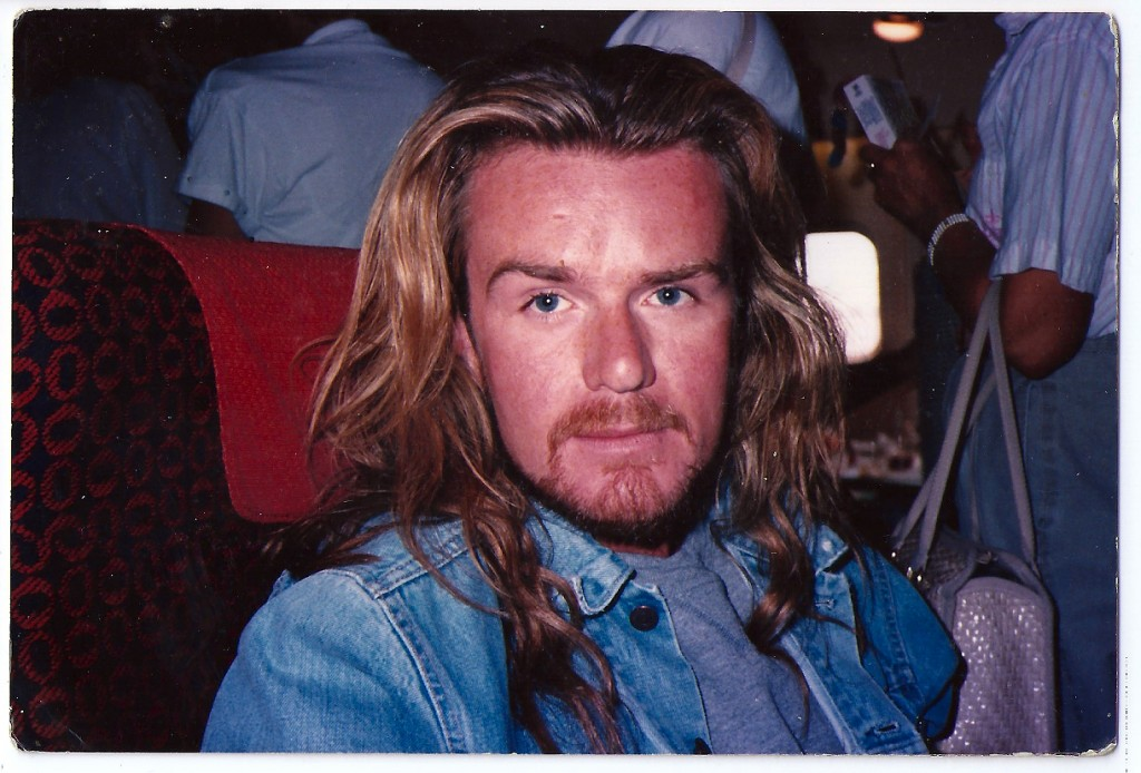 Billy Duffy rockin the Jesus look on a plane home from Hawaii 1990