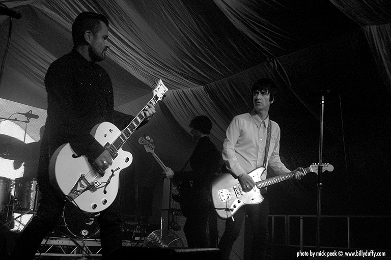 Billy Duffy onstage with Johnny Marr...