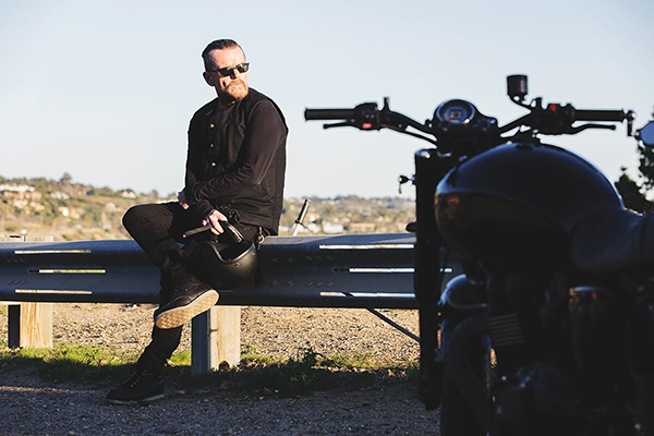 Billy Duffy and his black Triumph motorcycle